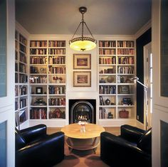 White bookshelves are the way to go so the focus can be on non-white items in the room! It simplifies and highlights beautifully! Home Library Design, House Design, Home Library Decor, Cozy Library, Library Shelves, Design Desk, Small Home Libraries, Library Fireplace, Library Bedroom