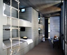bunk beds, rope ladder, closet space in between bunks