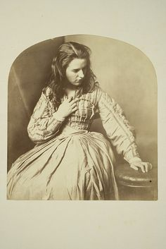 I think this photo was post-mortem. Her hand at the neckline of her dress doesn't seem to be in a natural position, and her eyes seem distant. The hand on the stool could well have been used to help prop her up. Her hair gives an appearance of having been neglected, perhaps due to illness.