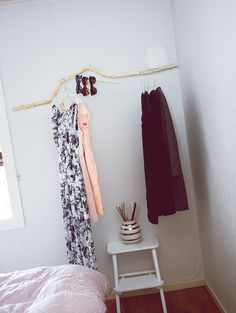 """DIY dressboy/stick for hanging dresses Found this stick in the woods, its hanging from the roof with fishing reels to make it look like its """"floating"""" in the air. Cheap and easy!"""