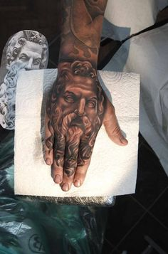 Portrait hand tattoo
