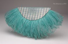 Fan-shaped clutch in silk brocade and ostrich feathers, circa 1938, Gift of Lee Evans, collection of Museum at FIT