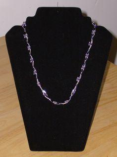 a little purple necklace.