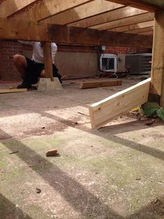 Evan sets a support post for the middle beam 14 Aug 14