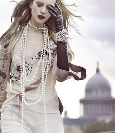 Pearls, lots of pearls...especially chic with long black gloves and diamond cuff bracelet