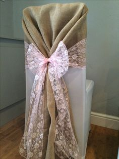 Wedding chair cover with hessian hood and pink lace sash. Hire in South Wales from www.affinityeventdecorators.com