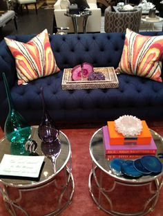 Love this navy sofa paired with Trina Turk peacock print in punch