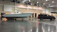 Gulfstream Yachts center console boat and matte black Line-X GMC Yukon XL Denali Center Console Fishing Boats, Yachts, Matte Black, Badass, Truck, Toy, Trucks, Clearance Toys, Toys