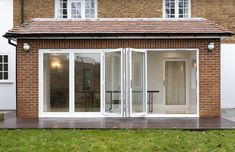 Kitchen extension invites more light into this period property Bifold Doors Onto Patio, White Bifold Doors, Folding Patio Doors, Bi Fold Doors, Kitchen Diner Extension, Open Plan Kitchen Diner, Glass Porch, Conservatory Design, Driveway Design