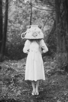 Alice in Wonderland inspired photo of girl with large tea cup on her head Photo by Lissy Elle