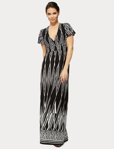 With waistband ties at the back, this knit maxi dress has a crossover V-neck.