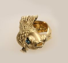 MAYA AND RUMEN  Master wax carvers who create tiny wearable sculptures based on birds, fish and other favorite creatures.