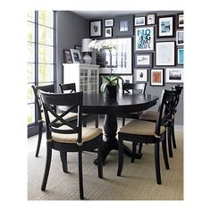 Round table that extends and can seat 6.  Crate & Barrel
