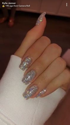 Nail art is a very popular trend these days and every woman you meet seems to have beautiful nails. It used to be that women would just go get a manicure or pedicure to get their nails trimmed and shaped with just a few coats of plain nail polish. Gem Nail Designs, Winter Nail Designs, Simple Acrylic Nails, Best Acrylic Nails, Sparkly Acrylic Nails, Clear Glitter Nails, Glittery Nails, Glitter Acrylics, Glitter Wedding Nails