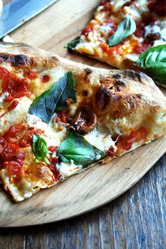 pizza with Tom Colicchio's oven-roasted tomatoes, garlic, and burrata