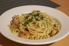 Pasta with prawns and white wine, garlic and butter sauce. Recipe is from http://www.seriouseats.com/recipes/2012/03/shrimp-scampi-with-artichokes-recipe.html