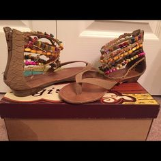 NWOT Gorgeous ankle beaded sandals!! These beautiful sandals are the perfect vacation shoes. Never worn, still in original box. Love them but have never gotten to wear them! Needs a new home Shoes Sandals
