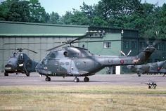 Puma HC1 XW209 / CF of 33Sqn with a pair of 18Sqn Wessex behind at RAF Gutersloh, Germany. 5th July 1975