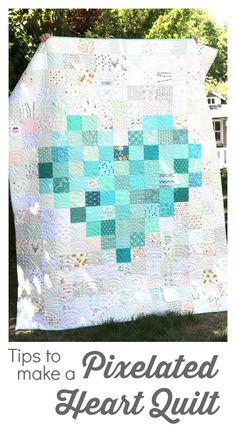 Pixelated Heart Patchwork Quilt - tips to make one This pixelated heart patchwork quilt is a great project for beginning quilters. Tips for layout and making your own pixelated heart quilt. Patchwork Quilt, Flag Quilt, Star Quilt Blocks, Patch Quilt, Mini Quilts, Baby Quilt Tutorials, Quilting Tutorials, Quilting Projects, Free Tutorials