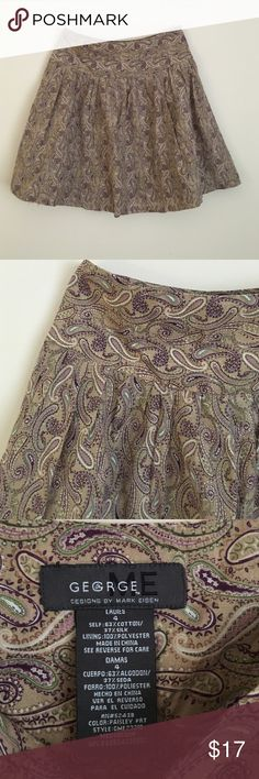 """George 4 cotton silk blend flared mini paisley Fun feminine George size 4 cotton silk blend lined skirt in a beautiful paisley pattern. Skirt features side zipper, 4"""" drop waist band, and mini pleats below for fun flowing flare. dimensions include: 28"""" waist, 36"""" hips and 19"""" length from top to bottom hem. George Skirts Mini"""