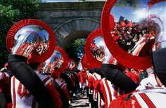 """As the fourth quarter begins, the tubas line up single file and begin an oom-pah-like interlude and parade around the perimeter of the gridiron. The repertoire for this parade includes such favorites as Semper Fidelis, Beer Barrel Polka and On Wisconsin. The march concludes in front of the rest of the Wisconsin Band with the singing of """"The finest fellows throughout the land are the tubas in the Wisconsin Band!"""""""