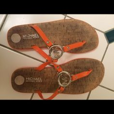 Used..Good Condition..Michael Kors Orange Sandals USED...GOOD CONDITION...MICHAEL KORS ORANGE SANDALS WITH SILVER MK LOGO. Great color for Summer to show off that tan!!! Shoes are a 10, but fit like a 9. Michael Kors Shoes Sandals