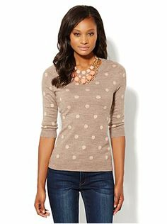 I like the polka dots on this sweater, but would like it better if it was looser fitting.