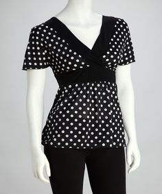 Black & White Polka Dot Surplice Top p style='margin-bottom:0px;'>Sweet retro style is alive and well in this polka dot top. The flattering surplice neckline, fluttery angel sleeves and smooth fabric with a hint of stretch make this shirt a timeless treasure.Measurements (size S): 29'' long from high point of shoulder to hem92% polyester / 8% spandexHand wash; hang dryMade in the USA