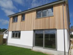 Siberian Larch Cladding. New Build! 4/5 Bedrooms, Beautiful Country Views and just a 5 min stroll via footpath across coastal view fields to Porthilly Cove. Rock, Cornwall. Now For Sale with Fine & Country, Rock Cornwall. Details on Rightmove.