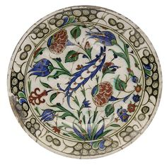 AN IZNIK POTTERY DISH   OTTOMAN TURKEY, EARLY 17TH CENTURY   On short foot, the bole-red, cobalt-blue, sage green and black decoration with gold highlights, a saz leaf in the centre Glazes For Pottery, Ceramic Pottery, Pottery Art, Ceramic Plates, Turkish Tiles, Turkish Art, Islamic Tiles, Islamic Art, Quartz Tiles