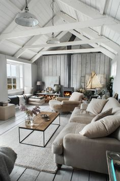 The farmhouse living room is more than just a classic style with barn doors and shiplap. In fact, there are many things you can do to refresh your space. The idea of the farmhouse living room is about creating a… Continue Reading → Modern Farmhouse Living Room Decor, Coastal Living Rooms, Cottage Living, My Living Room, Home And Living, Rustic Farmhouse, Cozy Living, Farmhouse Style, Coastal Cottage