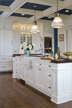 Kitchens by Deane: White and blue kitchen design with white shaker kitchen cabinets paired with butcher ...