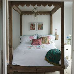 """Very """"Out of Africa"""" four poster bed with the addition of some sheer drapes"""