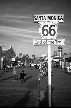 HISTORIC L.A. | THE WESTSIDE | SANTA MONICA:  This is a contemporary sign on the Santa Monica Pier fancifully marking the western end of the historic Route 66. It actually ended at the corner of Santa Monica Boulevard and Ocean Avenue.