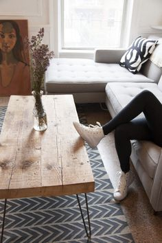 Love this handmade coffee table. I have been wanting to have legs like this made for my studio desk made from on antique pocket door.