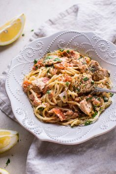 This creamy lemon and fresh tomato salmon pasta is a fresh and decadent pasta dish that's ready in only 20 minutes!
