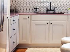 Really like the white cabinet with black knobs  Kitchen Design Tips From HGTV Stars : Rooms : HGTV