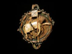 Ceiling boss of carved wood, unicorn carrying flag, with traces of original paintwork, from Linlithgow Palace, Scotland, c. 1617.