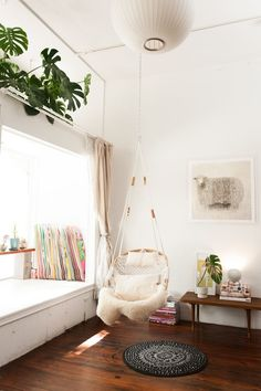 """How To DIY A Tiny Space — For Big Results #refinery29  http://www.refinery29.com/small-san-francisco-apartment#slide-11  Ignore Indoor/Outdoor Rules """"Who said swings were for outdoor use only? This swing from Gravel & Gold is a great spot for some magazine reading and, when the sun hits, napping.  Challenging the conventional use of items is always a DO!""""..."""