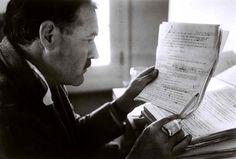 Hemingway editing aboard his boat. Photo by Robert Capa.