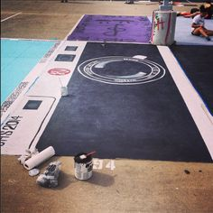"""At my high school, it's a custom for incoming seniors to purchase an assigned parking spot in the fabled """"seniors-only"""" lot, and paint it with any design or image that pleases their little young ad..."""