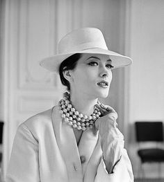 1960 Rose Marie in white wool coat topped by straw fedora by Madeleine de Rauch