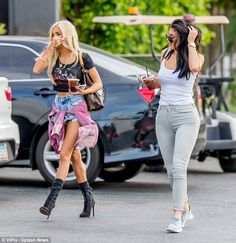 Show stealer: Kylie, 17, was joined by her close pal Pia Mia, who rocked a slightly more eye-catching look as they went to get some drinks after having dinner together