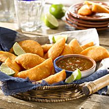 These typical Colombian-style empanadas are tasty turnovers made with savory yellow corn dough stuffed with seasoned pork and beef mixed with cooked potatoes. This recipe makes 30 empanadas!