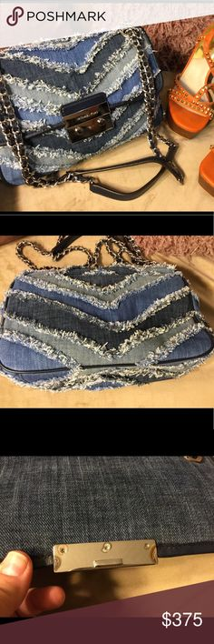 🎀MICHAEL KORS LARGE DENIM BAG🎀 Mesh MK Large Denim Chevron 🌹🌸 😍beautiful large MK denim crossbody . Chain link double strap, reminds me of Chanel 💗 can be worn as would've bag or crossbody 🌹🌸beautiful bag. Very well made 💫💫 fits all your essentials Michael Kors Bags Shoulder Bags