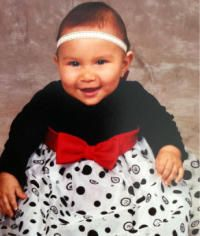 UPDATE:  Gabriela Quintero, almost 1, has been located safe. Her mother left her in the car for a minute while she ran back into the house only to come outside and find the car being driven away by an unknown Latina woman. An AMBER Alert was activated and the car with the child inside was located approximately 5 hours after the kidnapping and theft. The kidnapper is still at large.