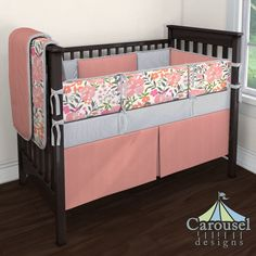 Crib bedding in Solid Light Coral, Cloud Gray Mini Stripe, Pink and Orange Floral Tropic. Created using the Nursery Designer® by Carousel Designs where you mix and match from hundreds of fabrics to create your own unique baby bedding. #carouseldesigns