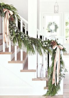 20 Gorgeous Holiday Decor Ideas   Holiday decorations for Christmas 2016 - oversized garland with pinecones + satin bows on the staircase