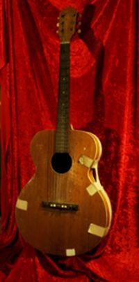 Elvis Presley's First Guitar, His Mother Bought It For Him For His Birthday  At The Local  Hardware Store for $6.95 He Really Wanted A Rifle Like All Kids Of His Age But His Mother Wouldn't Have That , No Way. And The Legend Begins.