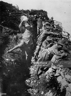 Italian alpinists defending an attack from a trench dug into the mountain during the First World War.